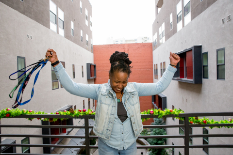 June holds up keys to her home at New Pershing apartments in downtown Los Angeles. Photo by Michael Brannigan.