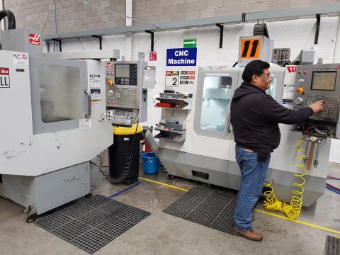 Ing. Ruben Fuentes, trabajando en la maquina CNC de la planta de SpotSee en Chihuahua, Mexico. (Foto ...