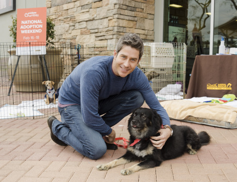 "Arie Luyendyk Jr., the current ""Bachelor,"" cuddles with his dog Bastian at a PetSmart Charities National Adoption Weekend event at a PetSmart store in Phoenix, Ariz., this past weekend. Arie adopted Bastian seven years ago and shared his personal adoption story to help encourage pet parents to adopt pets during PetSmart Charities National Adoption Weekend events held at nearly all PetSmart stores across North America from Feb. 16-18. This was the second-most-successful adoption event, with 29,739 pets finding their forever homes this past weekend. (Photo: Business Wire)"