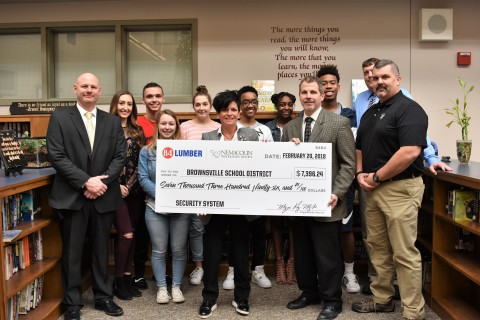 84 Lumber and Nemacolin Woodlands Resort President and Owner Maggie Hardy Magerko (center) presents to Brownsville School District so they can purchase and install new metal detectors. (Photo: Business Wire)