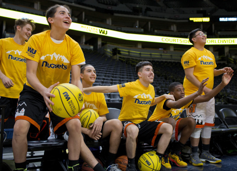 """Denver West High School varsity basketball players participate in """"Court of Dreams"""" experience hosted by the Western Union Foundation on the Denver Nuggets game court. (February 21, 2018) (Graphic: Business Wire)"""