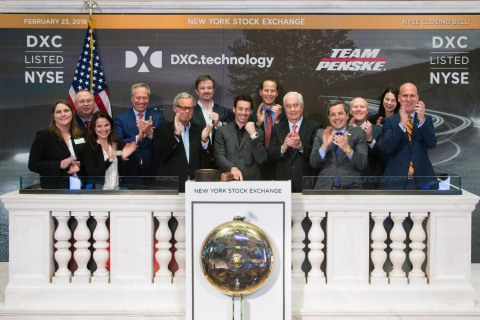 Driver Simon Pagenaud (center) rings the NYSE Closing Bell with Mike Lawrie (feft), DXC Technology chairman, president and CEO, and Roger Penske (right), founder and chairman of Penske Corporation on Feb. 23, 2018. (Photo: Business Wire)