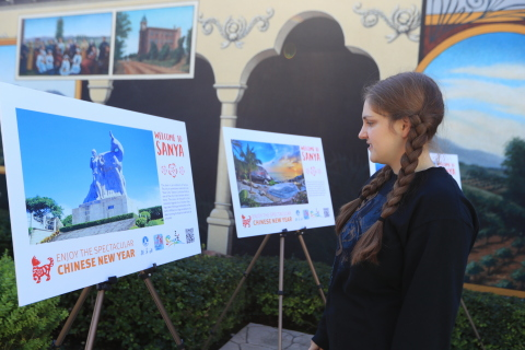 Ann from Arizona is watching the Sanya photo show (Photo: Business Wire)