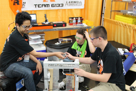 Members of the Haltom Robotics team from Haltom City, Texas, fine tune their robot at the 2017 FIRST Championship. (Photo: Business Wire)