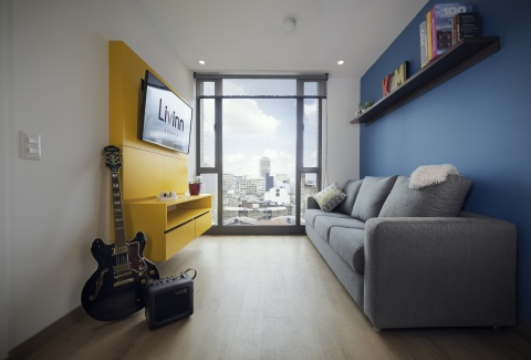 Livinn Calle 18 Living Room (Bogotá): Livinn Calle 18 in Bogotá, Colombia is a 479-bed student housing community developed by CA Ventures. The community offers students attending nearby universities an upscale lifestyle experience with well-appointed living spaces. (Photo: Business Wire)