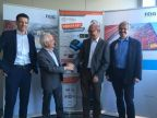 Good cooperation: A handshake between Eldor Walk, managing director of FEIG ELECTRONIC GmbH (2nd from right) and Peter Schmidt, founder of PANMOBIL, confirms the acquisition of the AutoID specialist by FEIG. Andreas Binder, head of PANMOBIL product line, from PANMOBIL (left) and Markus Desch, technical director, from FEIG (right) are responsible for the successful integration into the FEIG Group. (Photo: Business Wire)