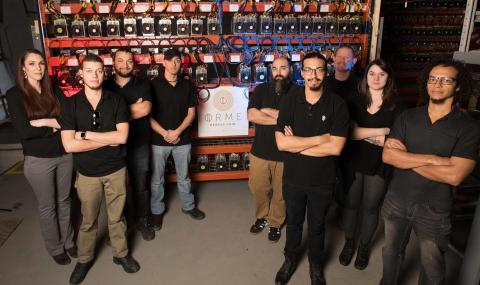 Hash Power: Some of the staff at the Ormeus Coin Cryptocurrency mining facility in upstate New York (Photo: Business Wire)