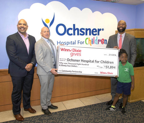 Winn-Dixie presents $51,894 to Ochsner Hospital for Children. Pictured from left to right: Trey Edwards, Winn-Dixie Regional Vice President, Alabama, Louisiana, Mississippi; Dr. Williams Lennarz, Ochsner Hospital for Children System Chair of Pediatrics; Thomas Harris, Jr., Ochsner Hospital for Children Vice President of Pediatrics; Dayja Davis, Ochsner Hospital for Children liver and kidney transplant survivor. (Photo: Business Wire)