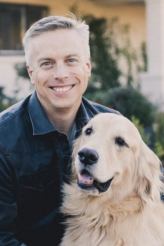 """David Haworth, DVM, PhD, president of PetSmart Charities and chair of the Research Working Group for the Human Animal Bond Research Institute (HABRI), will discuss """"The Power of Pets"""" at the inaugural South by Southwest® (SXSW) Wellness Expo on Sunday, March 11 in Austin, Texas. Dr. Haworth is pictured with his dog, Bridger, who also serves as a therapy dog. (Photo: Business Wire)"""