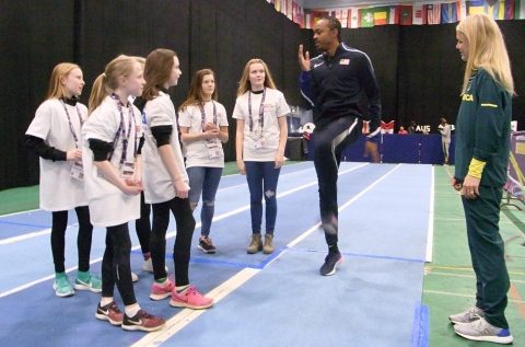 US hurdler Aries Merritt puts young athletes through their paces behind the scenes at the Arena Birmingham (Photo: Business Wire)