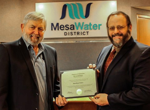 Mesa Water's President Atkinson and Vice President Bockmiller receiving the District of Distinction Re-Accreditation Award. (Photo: Business Wire)