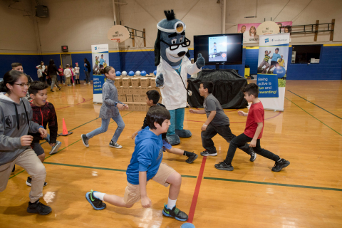 """UnitedHealthcare mascot Dr. Health E. Hound led members of Boys & Girls Clubs of Tucson to test their new NERF ENERGY Game Kits. Today's donation of 150 kits is part of a national initiative between Hasbro and UnitedHealthcare, featuring Hasbro's NERF products, that encourages young people to become more active through """"exergaming"""" (Photo: Laura Segall)."""