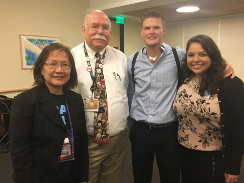Jim Harrison shared his story at a recent Grand Rounds presentation to mark the home mechanical ventilation program's 40th anniversary. (L-R): Sheila Kun, RN, Thomas Keens, MD, Harrison and his wife, Brittany. (Photo courtesy Jim Harrison)