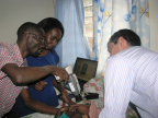 Volk's Pictor Plus camera being used to image a patient with cerebral malaria. (Photo: Business Wire)