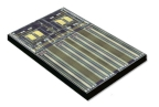MACOM's L-PIC platform provides a highly integrated silicon photonic solution targeting specific data center applications that includes four CW lasers, monitor photodiodes, high bandwidth waveguides, modulators and multiplexers. Utilizing MACOM's patented self-aligning etched facet technology (SAEFTTM) for precision attachment of the lasers to the silicon chip, the L-PIC platform removes the need for active laser alignment and offers a significant cost reduction to the customer, enabling mainstream deployment. (Photo: Business Wire)