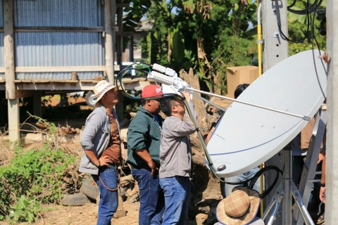 Engineers installing a satellite antenna in a rural location in Thailand (Photo: Business Wire)