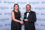 Patricia Morschel, Axalta's North America Refinish Director accepts Frost & Sullivan's 2017 Global Automotive Refinish Coatings Market Leadership Award from Frost & Sullivan's Jeff Frigstad, Global Vice President of Best Practices. (Photo: Axalta)