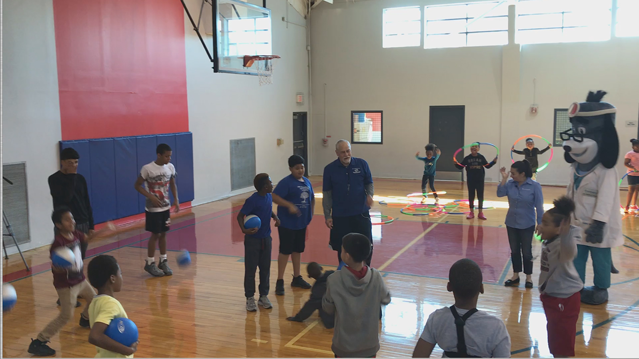 "Members of Boys & Girls Clubs of Greater Houston were led through exercises with UnitedHealthcare mascot Dr. Health E. Hound to test their new NERF ENERGY Game Kits that tracks activity earning ""energy points"" in order to play the game. Today's donation of 150 kits is part of a national initiative between Hasbro and UnitedHealthcare, featuring Hasbro's NERF products, that encourages young people to become more active through ""exergaming"" (Video: Anita Sen)."