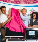 Dr. Clive Taylor, CMO, OptraSCAN, unveiling 3rd Gen High-Speed & Affordable Scanner in presence of founders Dr. Gauri Naik and Abhi Gholap (Photo: Business Wire)