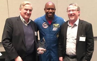 Edison Hudson and L Staton Noel receiving SPTC Award from Leland Melvin (Photo: Business Wire)