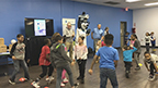 "Members of Boys & Girls Clubs of Southwest Virginia were led through exercises with Charles Wayland, executive director, UnitedHealthcare Community Plan of Virginia, and UnitedHealthcare mascot Dr. Health E. Hound to test their new NERF ENERGY Game Kits that track activity earning ""energy points"" in order to play the game. Today's donation of 100 kits is part of a national initiative between Hasbro and UnitedHealthcare, featuring Hasbro's NERF products, that encourages young people to become more active through ""exergaming"" (Video: Anita Sen)."