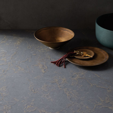 Haldi is a semi-translucent deep grey quartz pattern with warm gold veining. (Photo: Business Wire)