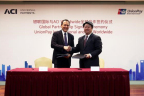 UnionPay International and ACI Worldwide signing ceremony in Shanghai; pictured: Mr. Cai Jianbo, CEO, UnionPay International and Dan Frate, group president, ACI Worldwide (Photo: Business Wire).