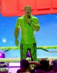 Host John Cena gets slimed onstage at Nickelodeon's 2018 Kids' Choice Awards at the Forum on March 24, 2018 in Inglewood, Calif. (Photo: Business Wire)