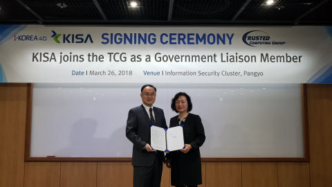 TCG Vice President Jing de Jong-Chen, Microsoft (right), welcomes the Korea Internet and Security Agency (KISA) as a government liaison member. (Photo: Business Wire)