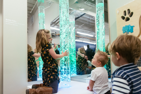 Children play with a bubble tube at the Vivint Smart Home Arena sensory room. (Photo: Business Wire)