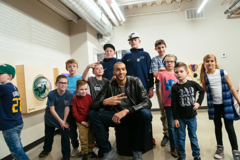 Utah Jazz center Rudy Gobert poses with children at the Vivint Smart Home Arena sensory room. (Photo: Business Wire)