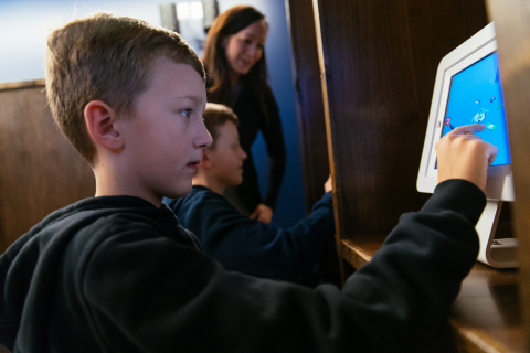 Children using the technology stations featuring Apple iPads at the Vivint Smart Home Arena sensory room. (Photo: Business Wire)