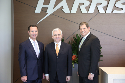 (L-to-R) Harris Chairman, President and CEO William M. Brown, U.S. Senator Jack Reed (D-RI) and Harr ...