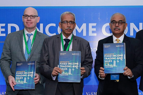 Ari Lehavi, Executive Director of Learning Solutions at Moody's Analytics, Gurumoorthy Mahalingam, Whole Time Member of the Securities Exchange Board of India (SEBI) and Sandip Ghose, Director of the National Institute of Securities Markets (NISM), launch the NISM-Moody's Analytics Certificate in Fixed Income Trading and Sales (CFITS) at the Moody's Analytics and NISM Fixed Income Conclave in March 2018.