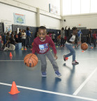 """Adjahani, a local Hartford Boys & Girls Club member, goes through a basketball drill during the kick-off event for National Boys & Girls Club Week. UnitedHealthcare and Hasbro sponsored the event by donating 100 NERF ENERGY Game Kits to the Boys & Girls Clubs of Hartford's Asylum Hill Unit. This initiative between Hasbro and UnitedHealthcare is designed to encourage kids to increase physical activity. The kits feature Hasbro's NERF products that are designed to encourage young people to become more active through """"exergaming"""" (Photo: Alan Grant / Digital Creations)."""