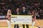 Western Union CEO, Hikmet Ersek presents $20,000 check on behalf of the Western Union Foundation to Bill Hanzlik, CEO and co-founder of the Gold Crown Foundation at Denver Nuggets game. (April 9, 2018) (Photo: Business Wire)