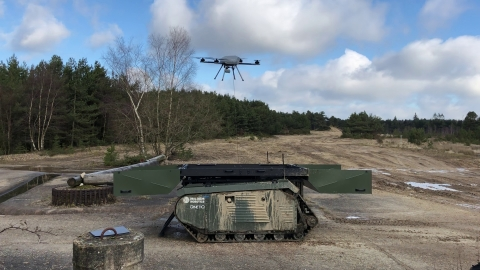 The THeMIS UGV by Milrem Robotics equipped with the KX-4 LE Titan UAV by Threod Systems is one examp ...