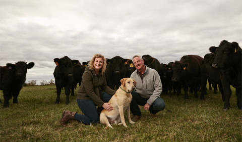 Tori Streitmatter won the 2017 #RootedinAg contest with an essay on her father, Dave. The two seen here on their family farm in Sparland, Illinois. (Photo: Business Wire)