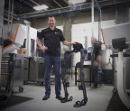 James Klassen, inventor of LiveDrive and chief technology officer of Genesis Robotics, stands next to the exoskeleton reference design built using LiveDrive actuators. Exoskeletons will help workers lift heavy objects with a lower risk of injury, improve prosthetics, allow soldiers to carry heavier loads and offer more natural mobility to people with physical restrictions. (Photo: Business Wire)