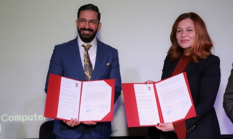 Dr. Ghada Hanin, AUT president signing the agreement with Mr. Ramiz Haddadin, Regional Commercial He ...