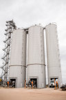 Trucks leaving silos at Hat Creek Facility (Photo: Business Wire)