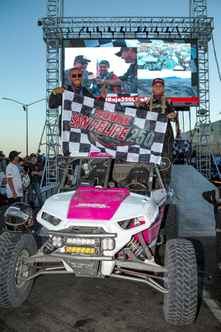 Kristen Matlock and Co-Driver Matthew Strandberg celebrate their victory (Photo: Business Wire)