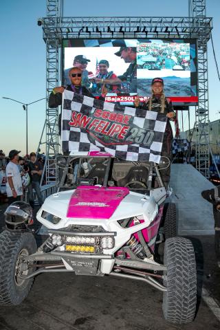 Kristen Matlock and Co-Driver Matthew Strandberg celebrate their victory (Photo: Business Wire)