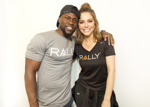 """Kevin Hart, Maria Menounos, Ron """"Boss"""" Everline and Rally Health Surprised Chicagoans at Midtown Athletic Club after Rally HealthFest - a free outdoor event promoting healthy living through fun activities - scheduled in Chicago's Maggie Daley Park was cancelled due to inclement weather. Here, Rally Health Ambassadors Kevin Hart and Maria Menounos are all smiles in Chicago after joining gymgoers in their morning workout. (Photo: Business Wire)"""