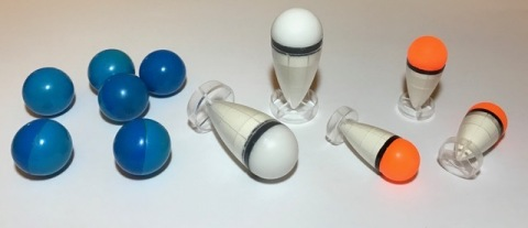 "Round ""paint balls"" and SDI's patented finned projectile. (Photo: Business Wire)"