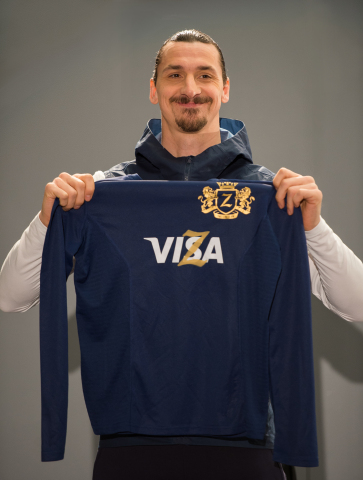 International football star Zlatan Ibrahimović adds his own unique flair to his Visa jersey to annou ...