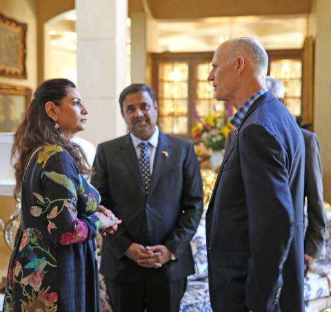 Governor Rick Scott of Florida and Industrialist Hotelier Danny Gaekward Discussing Kansai's Anti-Mosquito Paint with Kalpana Abe, Vice President, President's Office, Kansai Paint Co., Ltd. (Photo: Business Wire)