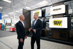 Amazon founder and CEO Jeff Bezos and Best Buy chairman and CEO Hubert Joly announce new Fire TV Edition smart TVs in Bellevue, WA. (Photo: Business Wire)
