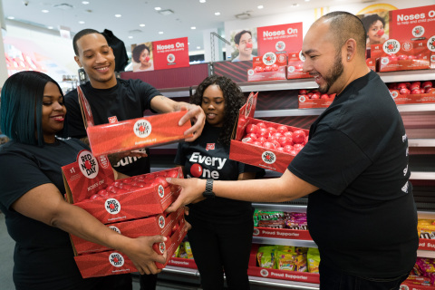 Walgreens team members stocking Red Noses at Walgreens store. (Photo: Business Wire)