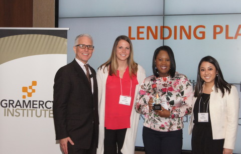 Sallie Mae employees receive the 2018 Financial Marketing Strategy Award from The Gramercy Institute. Pictured left to right is Bill Wreaks, CEO, Gramercy Institute and Sallie Mae employees Lillian Lowe, Lisa-Marie Jackson, and Jenny Cook. (Photo: Business Wire)